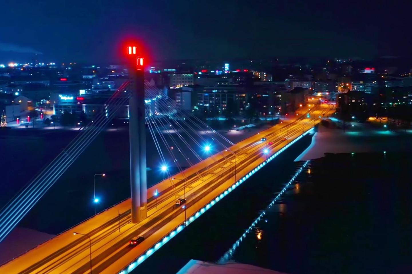 Cityscape by night, with a highway bridge