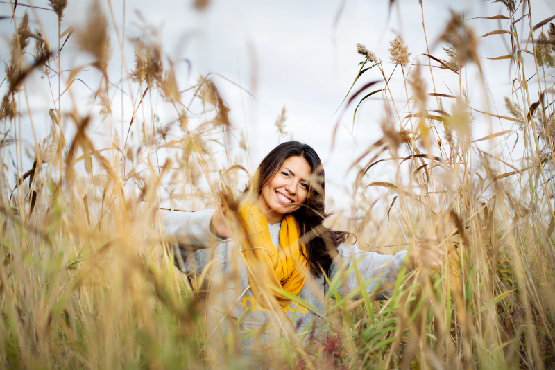 Picture of a smiling girl among reeds